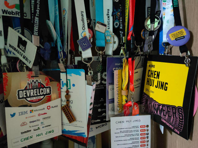 Conference badges hanging in my closet